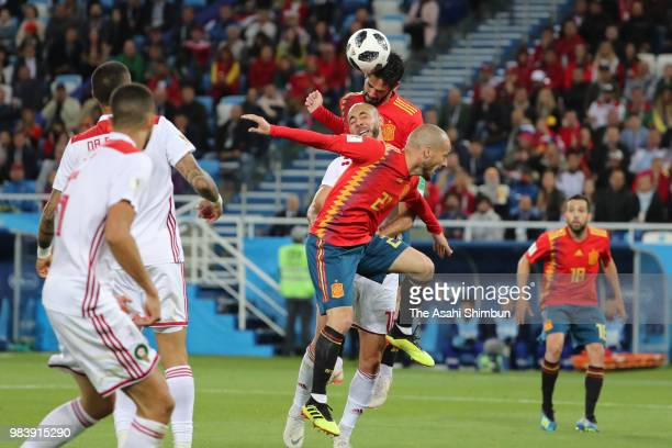 Isco of Spain and Noureddine Amrabat of Morocco compete for the ball during the 2018 FIFA World Cup Russia group B match between Spain and Morocco at...