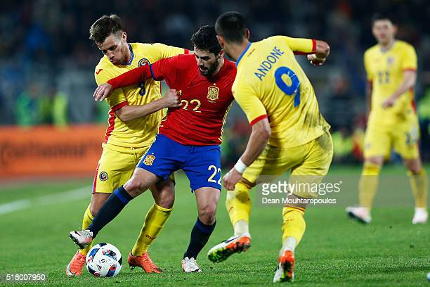 Isco of Spain battles for the ball with Mihai Pintilii and Florin Andone of Romania during the International Friendly match between Romania and Spain...