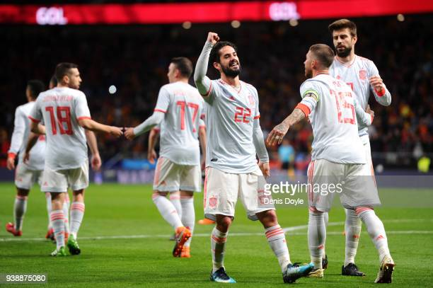 Isco of Spain celebrates after scoring his sides third goal with his team mates during the International Friendly between Spain and Argentina on...