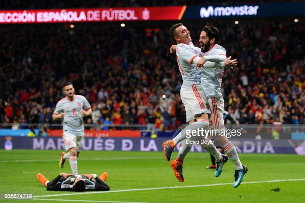 Isco of Spain celebrates after scoring his sides third goal with Iago Aspas of Spain during the International Friendly between Spain and Argentina on...