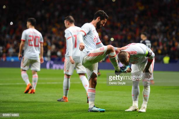 Isco of Spain celebrates after scoring his sides third goal with Sergio Ramos of Spain during the International Friendly between Spain and Argentina...