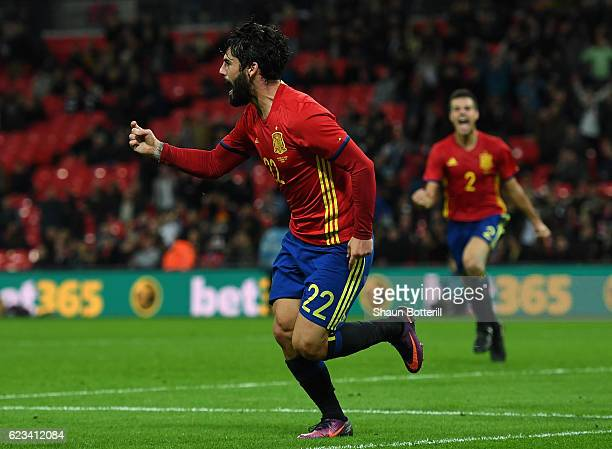 Isco of Spain celebrates as he scores their second and equalising goal during the international friendly match between England and Spain at Wembley...
