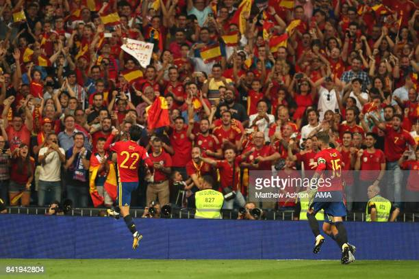 Isco of Spain celebrates scoring a goal to make the score 20 during the FIFA 2018 World Cup Qualifier between Spain and Italy at Estadio Santiago...