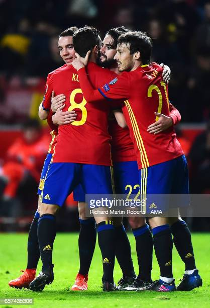 Isco of Spain celebrates scoring his team's fourth goal to make the score 4-1 with his team-mates during the FIFA 2018 World Cup Qualifier between...