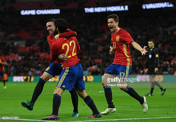 Isco of Spain celebrates with Iago Aspas and Ander Herrera as he scores their second and equalising goal during the international friendly match...