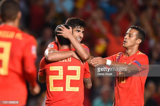 Isco of Spain celebrates with team mates as he scores his team's sixth goal with Marco Asensio and Thiago Alcantara during the UEFA Nations League A...
