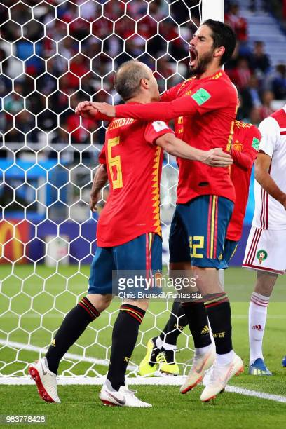 Isco of Spain celebrates with teammate Andres Iniesta after scoring his sides first goal during the 2018 FIFA World Cup Russia group B match between...