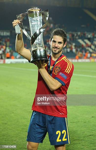 Isco of Spain celebrates with the trophy after winning the UEFA European U21 Championships Final match between Spain and Italy at Teddy Stadium on...