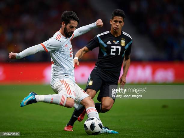 Isco of Spain competes for the ball with Cristian Pavon of Argentina during the International friendly match between Spain and Argentina at...