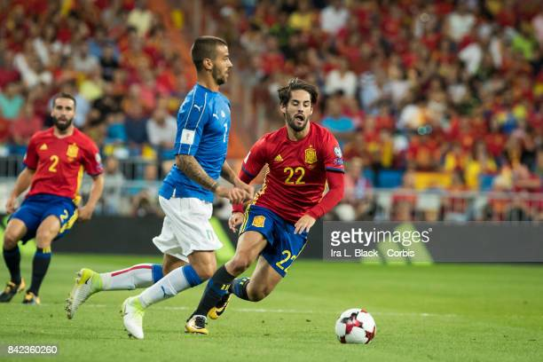 Isco of Spain fights for position against Leonardo Spinazzola of Italy during the World Cup qualifying match between Spain and Italy at the Santiago...