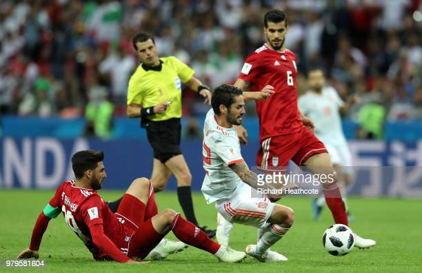 Isco of Spain is challenged by Alireza Jahanbakhsh and Saeid Ezatolahi of Iran during the 2018 FIFA World Cup Russia group B match between Iran and...