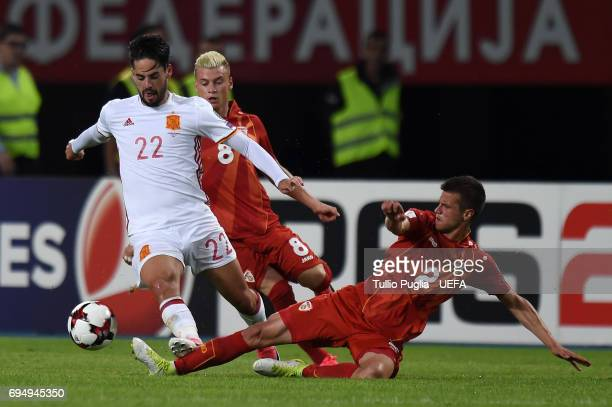 Isco of Spain is challenged by Kristijan Tosevski during the FIFA 2018 World Cup Qualifier between FYR Macedonia and Spain at Nacional Arena Filip II...