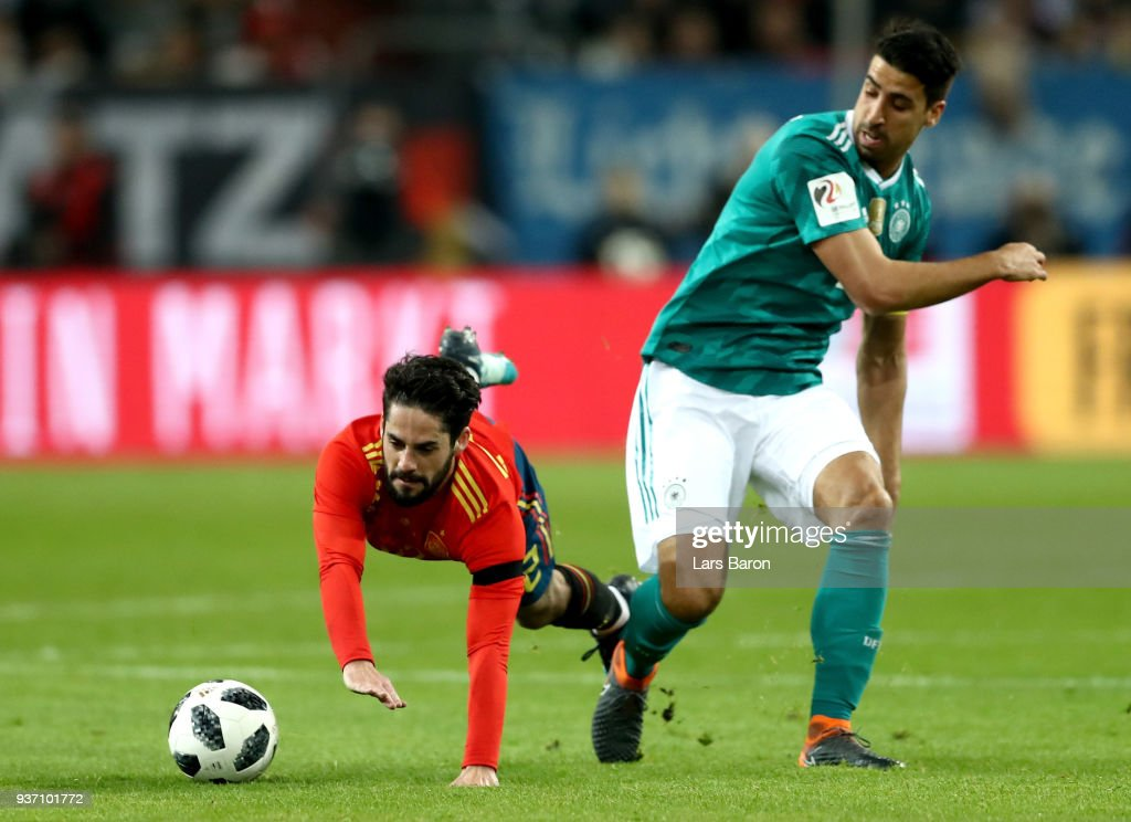 Isco of Spain is challenged by Sami Khedira of Germany during the International friendly match between Germany and Spain at Esprit-Arena on March 23, 2018 in Duesseldorf, Germany.