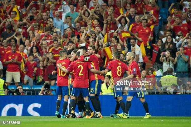 Isco of Spain is congratulated by teammates Sergio Ramos Dani Carvajal Koke and Jordi Alba during the World Cup qualifying match between Spain and...