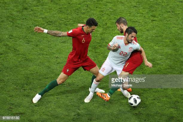 Isco of Spain is tackled by Bernardo Silva of Portugal and Jose Fonte of Portugal during the 2018 FIFA World Cup Russia group B match between...
