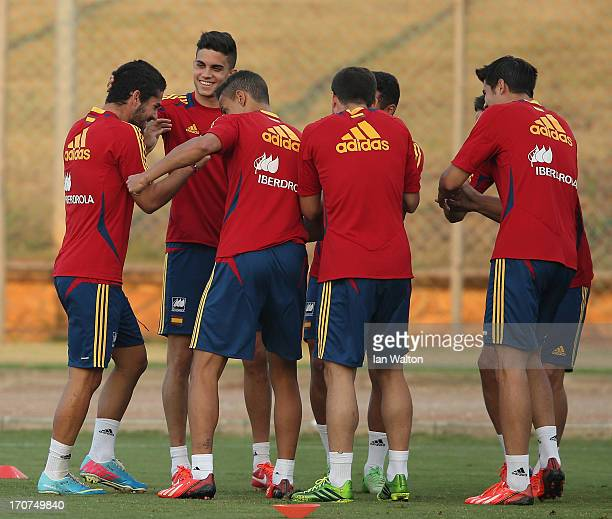 Isco of Spain jokes with teammates during a Spain Training Session before the UEFA European U21 Championships final at Kfar Saba Stadium on June 17...