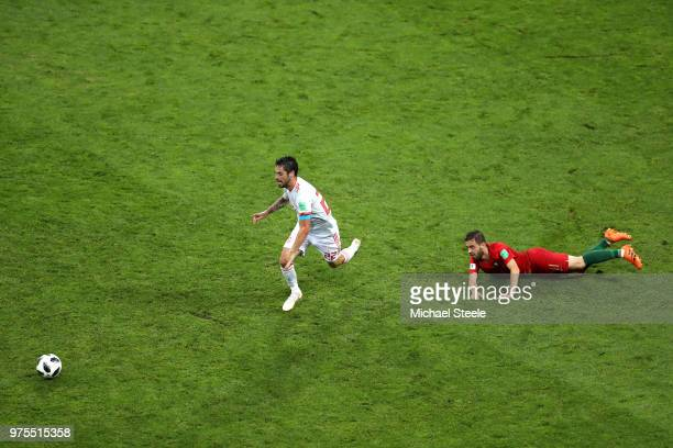 Isco of Spain runs with the ball away from a challenge by Bernardo Silva of Portugal during the 2018 FIFA World Cup Russia group B match between...