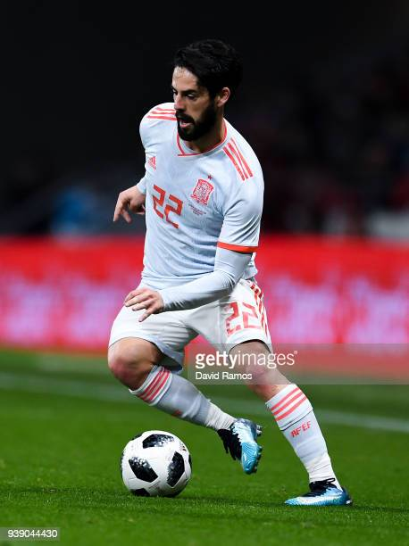 Isco of Spain runs with the ball during an International friendly match between Spain and Argentina at the Wanda Metropolitano stadium on March 27...