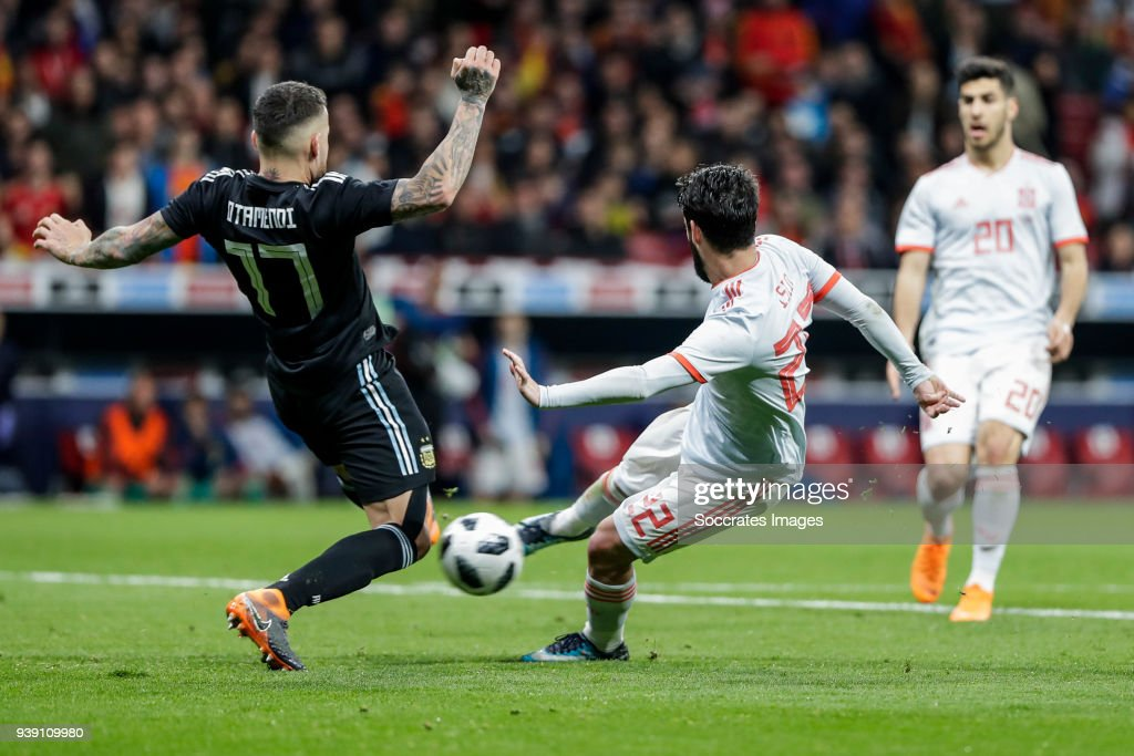 Isco of Spain scores the second goal to make it 2-0, Nicolas Otamendi of Argentina during the International Friendly match between Spain v Argentina at the Estadio Wanda Metropolitano on March 27, 2018 in Madrid Spain