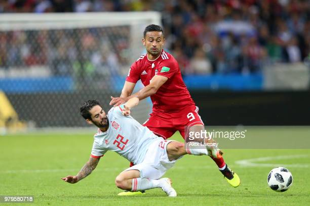 Isco of Spain tackles Omid Ebrahimi of Iran during the 2018 FIFA World Cup Russia group B match between Iran and Spain at Kazan Arena on June 20 2018...