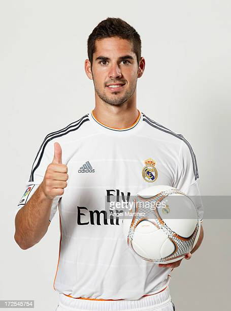 Isco poses during his official presentation as new Real Madrid player at the Santiago Bernabeu stadium on July 3 2013 in Madrid Spain