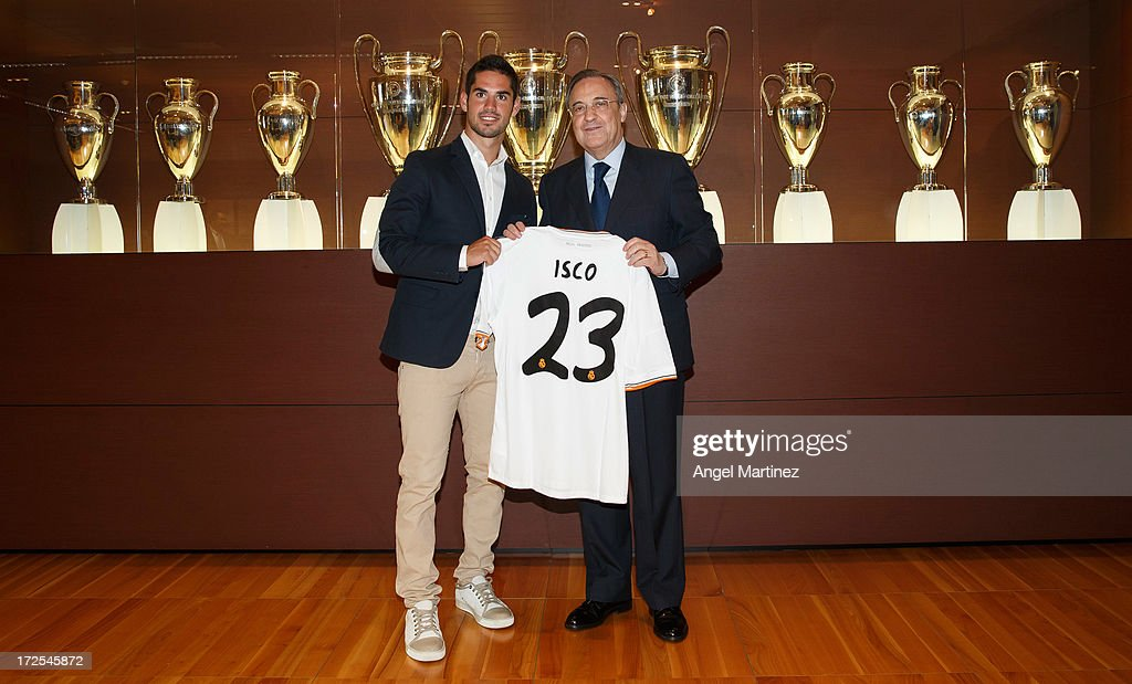 Isco (L) poses with Real Madrid's president Florentino Perez during his official presentation at the Santiago Bernabeu stadium on July 3, 2013 in Madrid, Spain.