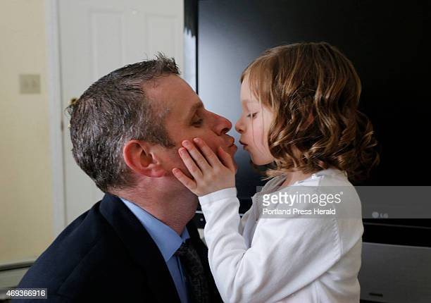 IScott Corbett gets a kiss from his daughter Nia before they leave for the father/daughter dance in South Portland