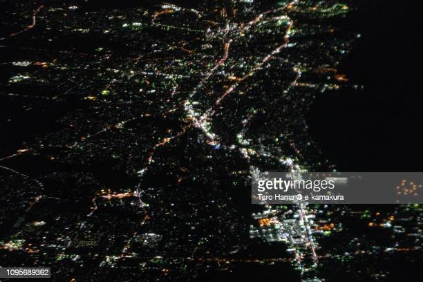 Ise Bay and Tsu city in Mie prefecture in Japan night time aerial view from airplane