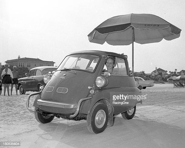 Isetta on the beach in Daytona during Speed Weeks The car originally of Italian design was the first mass produced microcar made for city driving...
