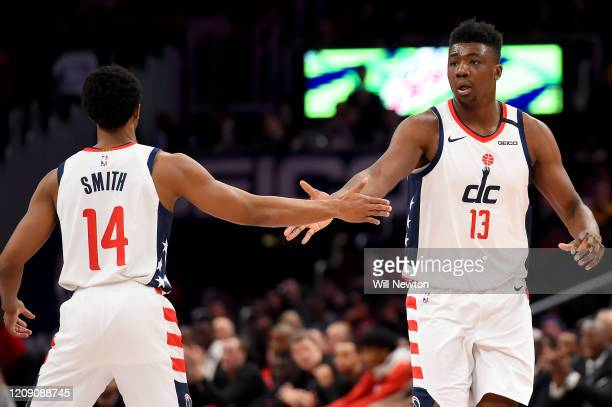 Ish Smith and Thomas Bryant of the Washington Wizards celebrate after a play against the Brooklyn Nets during the second half at Capital One Arena on...