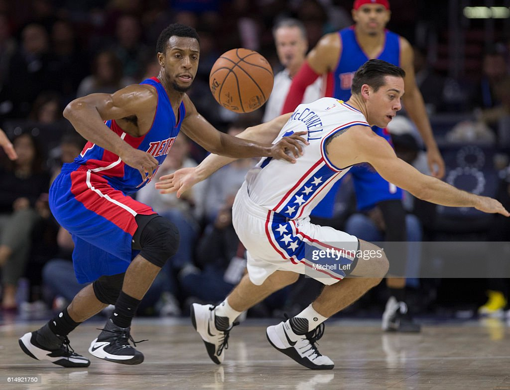 Ish Smith #14 of the Detroit Pistons and T.J. McConnell #1 of the Philadelphia 76ers chase after the ball in the second half at Wells Fargo Center on October 15, 2016 in Philadelphia, Pennsylvania. The Pistons defeated the 76ers 97-76.