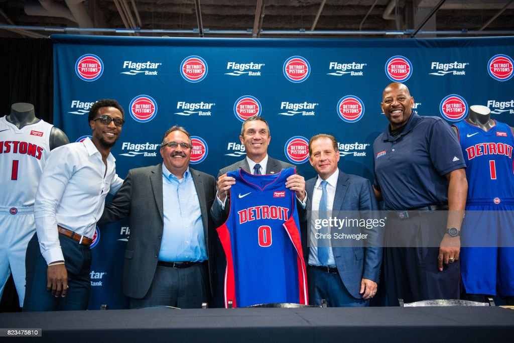 Ish Smith #14 of the Detroit Pistons, Detroit Pistons president of operations, Stan Van Gundy, CEO of Flagstaff Bank, Alessandro P. DiNello, Vice Chairman of the Pistons and Palace Sports Entertainment, Arn Tellem, and Detroit Pistons Legend, Earl Cureton pose with the new uniform on July 26, 2017 at the Nike Store in Detroit, Michigan.