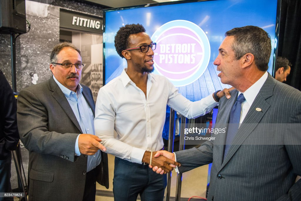 Ish Smith #14 of the Detroit Pistons, Detroit Pistons president of operations, Stan Van Gundy and CEO of Flagstaff Bank, Alessandro P. DiNello shake hands as they announce they will add Flagstar Bank as a sponsor on the left chest of the new uniforms on July 26, 2017 at the Nike Store in Detroit, Michigan.