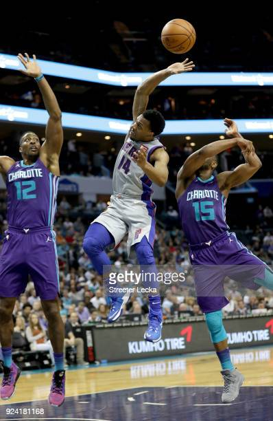 Ish Smith of the Detroit Pistons drives to the basket against Teammates Dwight Howard and Kemba Walker of the Charlotte Hornets during their game at...