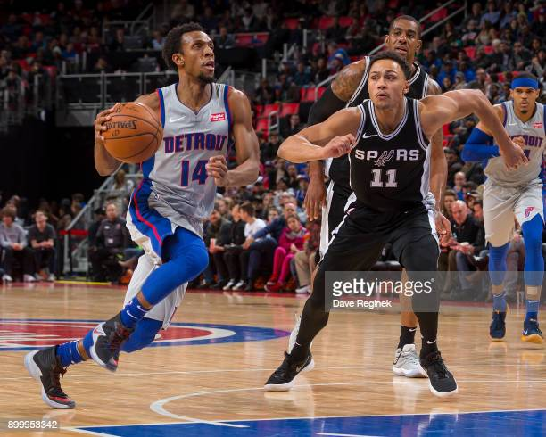 Ish Smith of the Detroit Pistons drives to the basket next to Bryn Forbes of the San Antonio Spurs in the second half of an NBA game at Little...