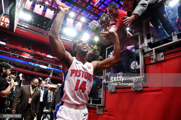 Ish Smith of the Detroit Pistons high fives fans after the game against the New York Knicks on November 27 2018 at Little Caesars Arena in Detroit...
