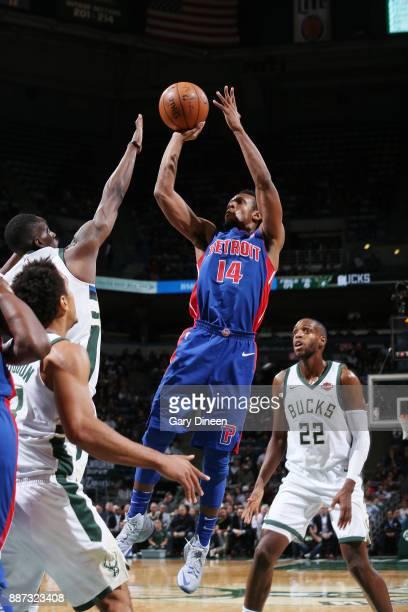 Ish Smith of the Detroit Pistons shoots the ball against Khris Middleton of the Milwaukee Bucks on December 6 2017 at the BMO Harris Bradley Center...