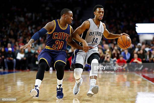 Ish Smith of the Detroit Pistons triers to drive around Kay Felder of the Cleveland Cavaliers during the first half at the Palace of Auburn Hills on...