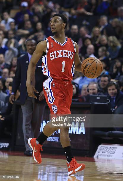 Ish Smith of the Philadelphia 76ers dribbles the ball during the first half of an NBA game against the Toronto Raptors at the Air Canada Centre on...