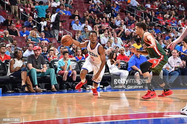 Ish Smith of the Philadelphia 76ers drives baseline against the Milwaukee Bucks at Wells Fargo Center on April 13 2015 in Philadelphia Pennsylvania...