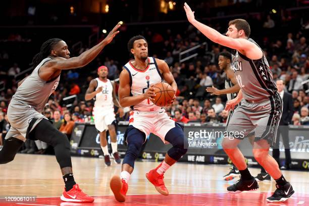 Ish Smith of the Washington Wizards dribbles in front of DeAndre Jordan and Joe Harris of the Brooklyn Nets during the first half at Capital One...