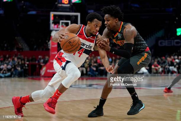 Ish Smith of the Washington Wizards dribbles past Brandon Goodwin of the Atlanta Hawks in the second half at Capital One Arena on January 10 2020 in...