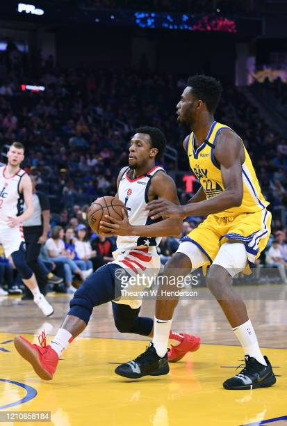 Ish Smith of the Washington Wizards drives towards the basket on Andrew Wiggins of the Golden State Warriors during the first half of an NBA...