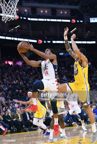 Ish Smith of the Washington Wizards goes in for a layup over Juan ToscanoAnderson of the Golden State Warriors during the first half of an NBA...