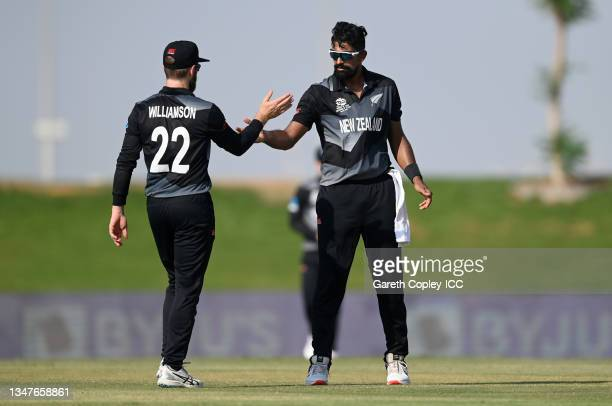 Ish Sodhi of New Zealand celebrates with Kane Williamson after dismissing Jos Buttler of England during the England and New Zealand warm Up Match...