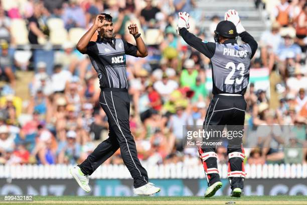 Ish Sodhi of New Zealand is congratulated by Glenn Phillips of New Zealand after dismissing Andre Fletcher of the West Indies during game one of the...