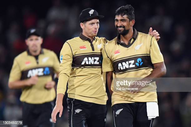 Ish Sodhi of New Zealand is congratulated by Mitchell Santner of New Zealand after dismissing Daniel Sams of Australia during game one of the Men's...