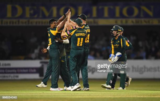 Ish Sodhi of Nottingham celebrates with his team mates after getting a wicket during the Vitality Blast match between Derbyshire Falcons and Notts...