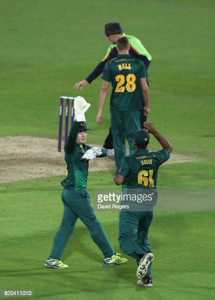 Ish Sodhi of Nottinghamshire celebrates with team mate Tom Moores after their victory during the NatWest T20 Blast match between Nottinghamshire...