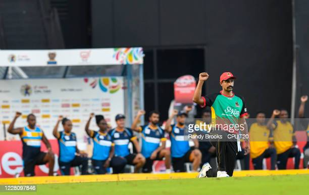 Ish Sodhi of St Kitts & Nevis Patriots kneel for Black Lives Matter at the start of the Hero Caribbean Premier League match 2 between Barbados...